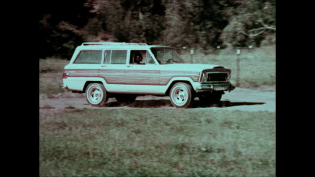 1975 jeep wagoneer montage - curious cumulus productions stock videos and b-roll footage