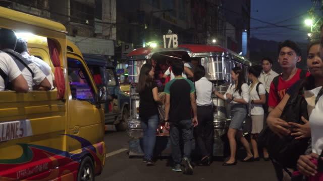 Jeepney transportation at Cebu city Colon street at night b-roll, Philippines