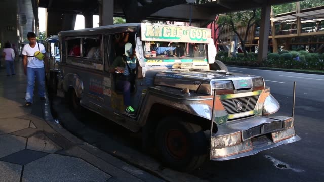 A jeepney waits at a jeepney stop in the Makati district of Manila the Philippines on Monday Nov 16 Passengers wait inside a jeepney in the Makati...