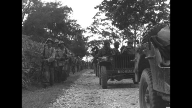 """jeeps and foot soldiers pass sign """"station experimentale de xiang khouang"""" in laos during indochina war / french far east expeditionary force... - laos stock videos & royalty-free footage"""