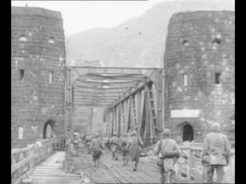 jeeps drive after having crossed ludendorff bridge in world war ii / montage soldiers approach bridge and begin to cross other soldiers keep watch... - flugabwehr stock-videos und b-roll-filmmaterial