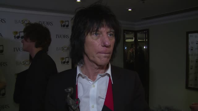 vídeos y material grabado en eventos de stock de interview jeff beck jimmy page on award history playing style friendship and guitars at the ivor novello awards 2014 at the grosvenor house hotel on... - hotel grosvenor house londres