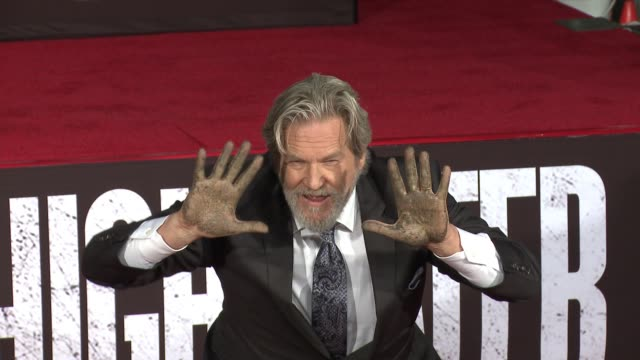 CHYRON Jeff Bridges places his Handprints and Footprints in Cement in Los Angeles CA