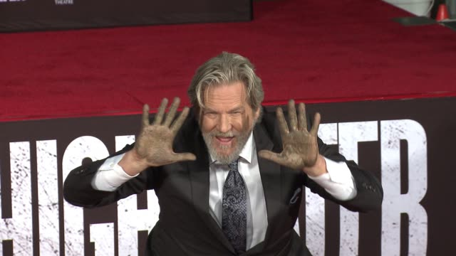 CLEAN Jeff Bridges places his Handprints and Footprints in Cement in Los Angeles CA