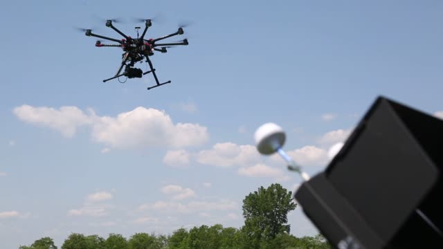 jeff brink director of flight ops and co founder of aerocine and michael ferguson chief pilot fly a dji s1000 drone in brooklyn us on wednesday june... - hovering stock videos & royalty-free footage