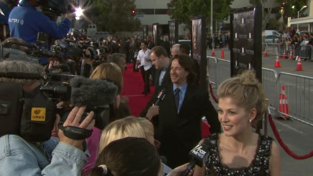 jeff danna and rosamund pike at the 'fracture' premiere at the mann village theatre in westwood california on april 11 2007 - rosamund pike stock videos & royalty-free footage