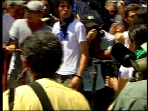 jeff duritz interview sot wide range of groups here ms group of protesters some with scarves over faces ms one protester holding wooden pole... - woodwind instrument stock videos and b-roll footage