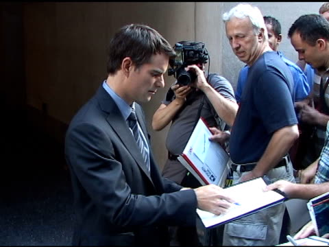 jeff gordon signs autographs for fans before departing the 'today show' in new york 07/26/11 - autographing stock videos & royalty-free footage