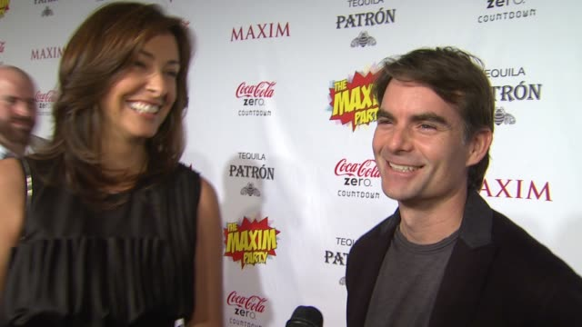jeff gordon with ingrid vandebosch on what brings him out the the maxim super bowl party what super power he would most like to have who he thinks is... - paul mitchell stock videos and b-roll footage
