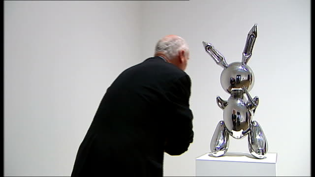 jeff koons balloon animal sculpture as examined by reporter and reflective surface of animal sculpture koons bust of himself and former wife italian... - bust sculpture stock videos and b-roll footage