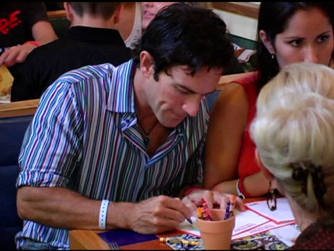 jeff probst coloring peppers at the chili's create a pepper to benefit st jude children's research hospital at chili's restaurant in westwood... - chili's grill & bar stock videos and b-roll footage