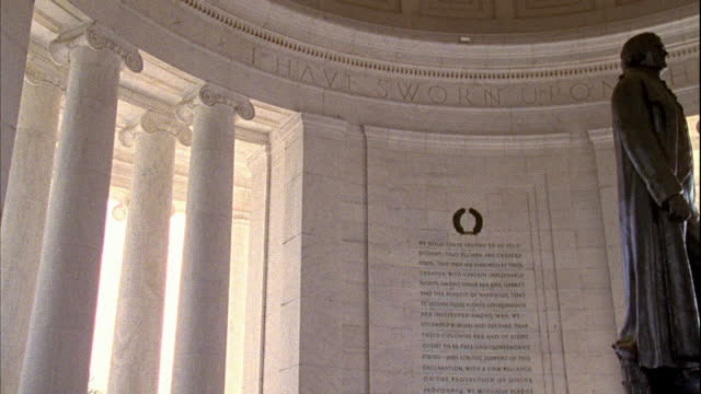 jefferson memorial with declaration of independence preamble carved on wall amp statue of thomas jefferson standing center of portico - thomas jefferson stock videos & royalty-free footage