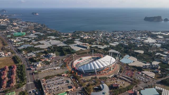 jeju world cup stadium and seascape with beomseom island / seogwipo-si, jeju-do, south korea - general motors stock videos & royalty-free footage