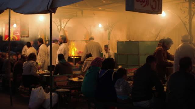 Jemaa el fna cookshop at night.