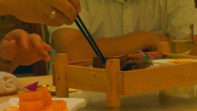 jenging, chinaman eating chinese food - ziegenbart stock-videos und b-roll-filmmaterial