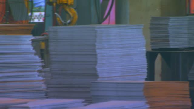 jenging, chinasheet metal stacks - sheet metal stock videos and b-roll footage