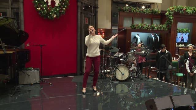 """performance – jenn gambatese performs """"winter wonderland"""" at brooks brothers celebrates the holidays with st jude children's research hospital at... - st. jude children's research hospital stock videos and b-roll footage"""