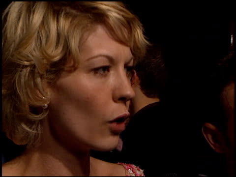 jenna elfman at the edtv premiere at universal amphitheatre in universal city, california on march 16, 1999. - jenna elfman stock videos & royalty-free footage