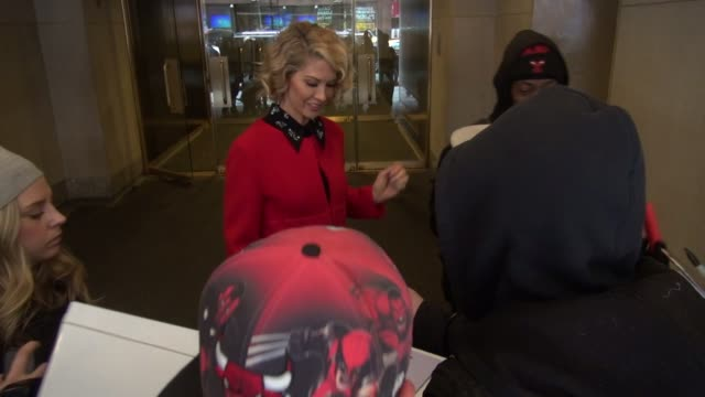 Jenna Elfman exits the Today show in Rockefeller Center poses with signs for fans in Celebrity Sightings in New York