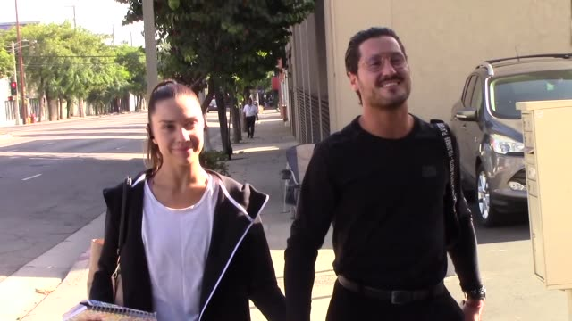 jenna johnson val chmerkovskiy hold hands outside the dwts rehearsal studio in hollywood in celebrity sightings in los angeles - dancing with the stars stock videos & royalty-free footage
