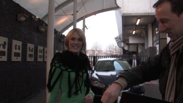 vídeos de stock, filmes e b-roll de jenni falconer leaving gmtv after appearing to talk about her time backstage at the brits. dressed in a lightweight green dress she bravely ignored... - lightweight