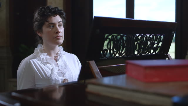 MS R/F POV Jennie Jerome playing piano / United Kingdom