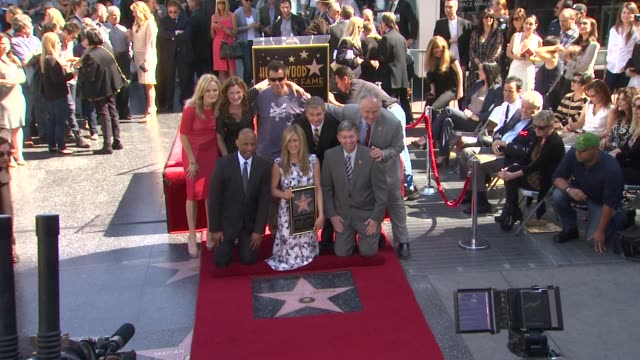 jennifer aniston, kathryn hahn, malin akerman, and adam sandler at jennifer aniston honored with star on the hollywood walk of fame in hollywood, ca,... - キャスリン ハーン点の映像素材/bロール
