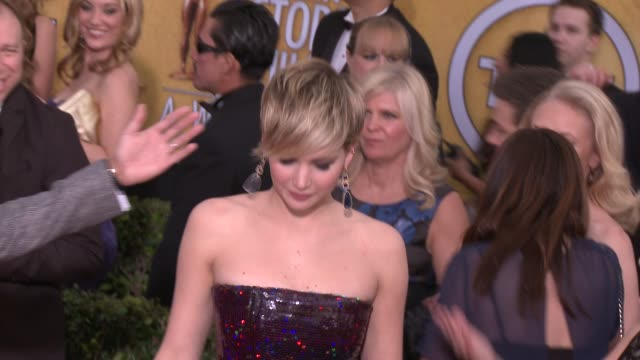 jennifer lawrence at 20th annual screen actors guild awards arrivals at the shrine auditorium on in los angeles california - シュラインオーディトリアム点の映像素材/bロール