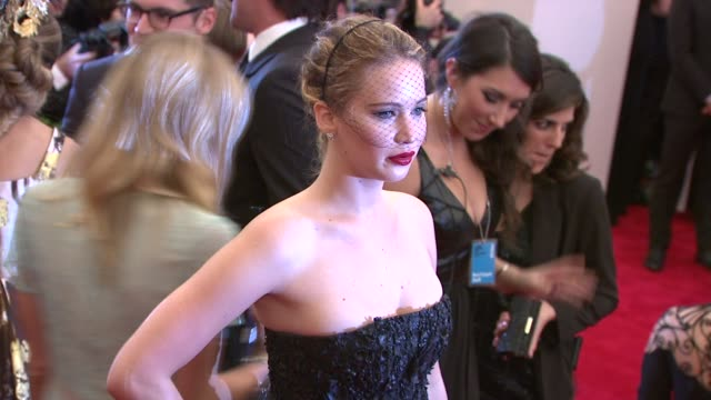 """jennifer lawrence at """"punk: chaos to couture"""" costume institute gala at metropolitan museum of art on may 06, 2013 in new york, new york - 黒のドレス点の映像素材/bロール"""