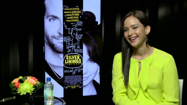 jennifer lawrence on what it's like being a celebrity and her love for bradley cooper - interview raw footage stock videos & royalty-free footage