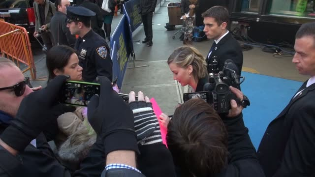 jennifer lawrence signs and poses for photos with fans outside the set of the good morning america show in celebrity sightings in new york - good morning america stock videos and b-roll footage