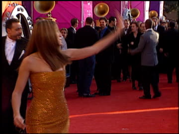 stockvideo's en b-roll-footage met jennifer lopez at the 1999 grammy awards at the shrine auditorium in los angeles, california on february 24, 1999. - 1999