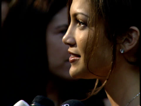 Jennifer Lopez speaks to reporters on the red carpet