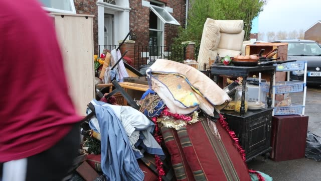 jenny kay removes flood damaged property from her house on warwick road in carlisle, cumbria on tuesday 8th december 2015, after torrential rain from... - environmental cleanup stock videos & royalty-free footage