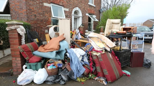 jenny kay removes flood damaged property from her house on warwick road in carlisle, cumbria on tuesday 8th december 2015, after torrential rain from... - ティンセル点の映像素材/bロール