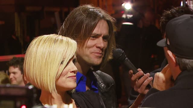 jenny mccarthy and jim carrey at the 'the number 23' premiere at the orpheum in los angeles, california on february 13, 2007. - ジェニー・マッカーシー点の映像素材/bロール