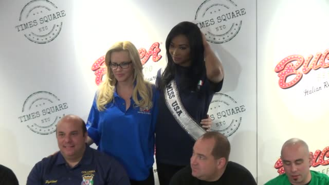 jenny mccarthy and miss usa 2012, nana meriwether attend the 2013 national ravioli day pasta eating contest at buca di beppo in new york, ny, on... - ジェニー・マッカーシー点の映像素材/bロール