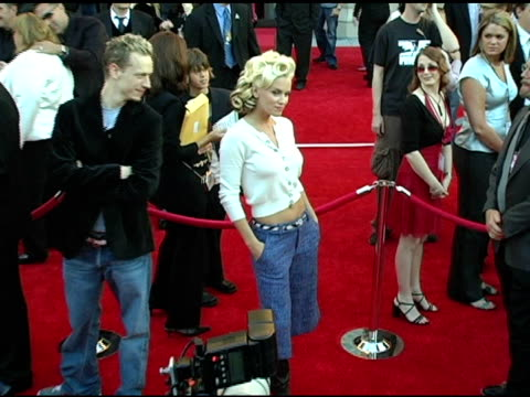 jenny mccarthy at the 2004 american music awards red carpet at the shrine auditorium in los angeles, california on november 14, 2004. - ジェニー・マッカーシー点の映像素材/bロール