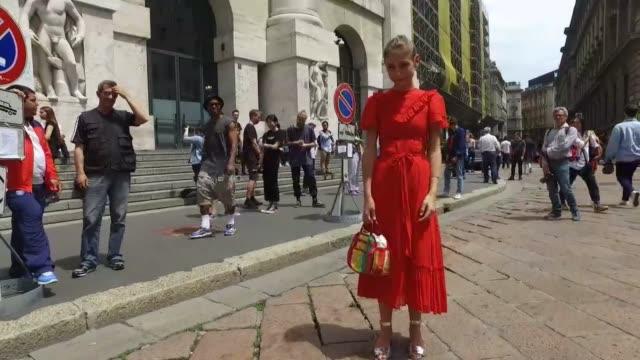 Jenny Walton wearing a vintage dress and bag and a Prada bag during Milan Men's Fashion Week SS17 on June 19 2016 in Milan Italy