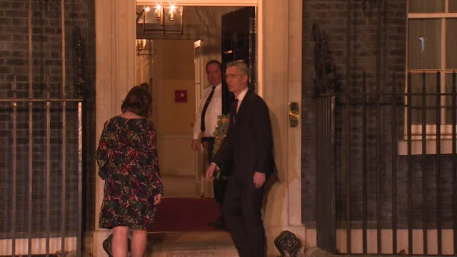 jens stoltenberg, nato secretary general, and wife, arrive at 10 downing street for meeting during nato summit - フォトコール点の映像素材/bロール