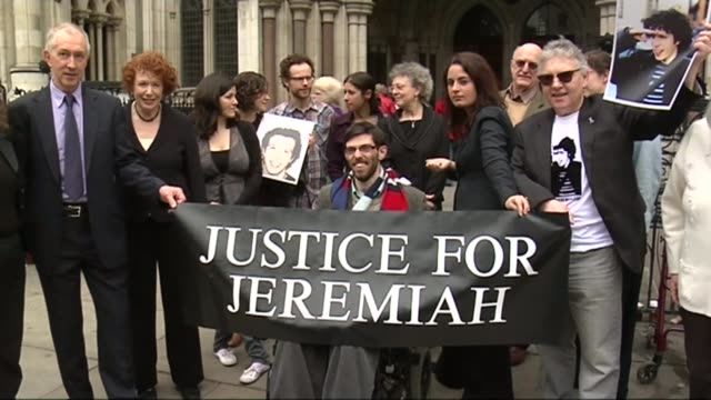 second inquest opens t20051053 / 2052010 england london family and friends of jeremiah duggan posing outside the high court with a banner reading... - inquest stock videos & royalty-free footage