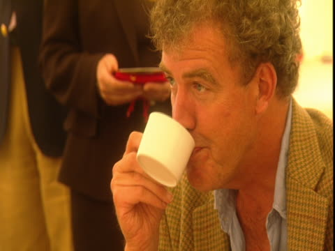 jeremy clarkson drinks a cup of tea at the goodwood festival of speed. - jeremy clarkson stock videos & royalty-free footage
