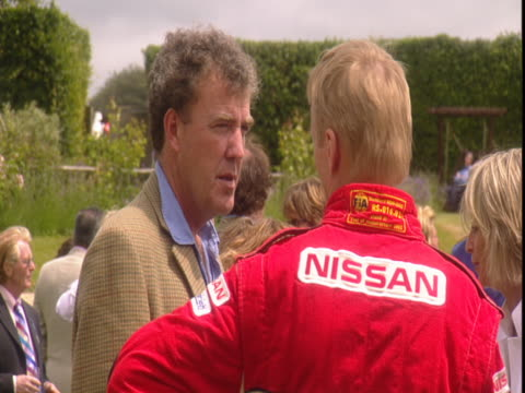 jeremy clarkson talks with a race track driver at the goodwood festival of speed - jeremy clarkson stock videos & royalty-free footage