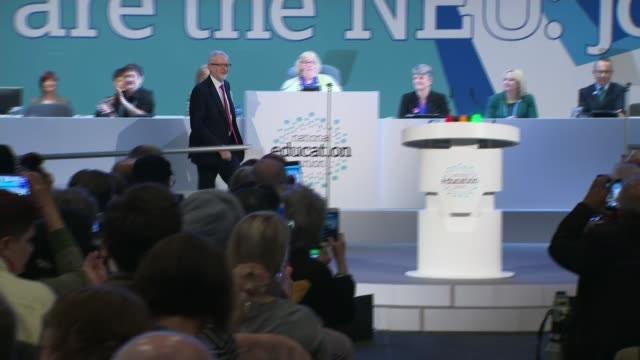 Jeremy Corbyn calls for SATs to be scrapped in England's primary schools ENGLAND Merseyside Liverpool INT Jeremy Corbyn MP along stage to podium...