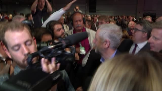 jeremy corbyn elected as labour leader corbyn and tom watson mp along through crowd and press scrum - スクラム点の映像素材/bロール