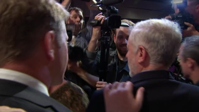 jeremy corbyn elected as labour leader reporter to camea jeremy corbyn waving to audience from stage in background/ member in audience holds up... - スクラム点の映像素材/bロール