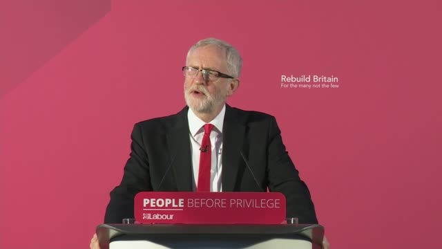 jeremy corbyn gives speech berating boris johnson for using queen's speech as party political broadcast and plots election manifesto england east... - northampton stock-videos und b-roll-filmmaterial