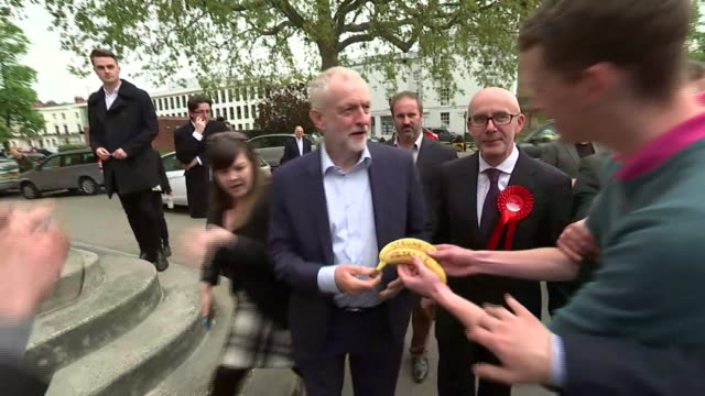 jeremy corbyn is offered 'strong and stable bananas' by a member of the public in leamington spa - leamington spa stock videos & royalty-free footage
