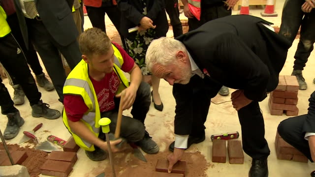 Jeremy Corbyn joking with a bricklayer