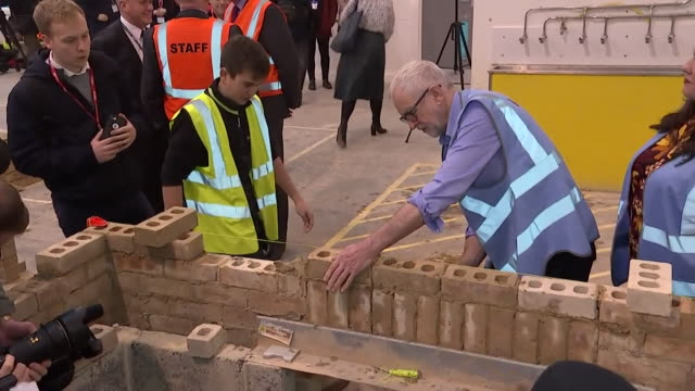 jeremy corbyn, labour leader, building brick wall during visit to a london college, during the general election campaign - brick stock videos & royalty-free footage